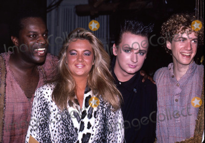 Boy George Photo - Boy George with Ron Richardson Cornelia Guest and Daniel Jenkins attending a Broadway performance of Big River on June 10 1985 at Eugene ONeill Theatre in New York City Credit McBrideface to face