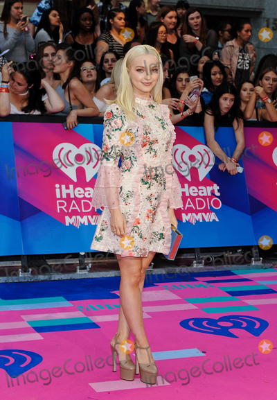 Dove Cameron Photo - 18 June 2017 - Toronto Ontario Canada  Dove Cameron arrives on the pink carpet at the 2017 iHeartRadio MuchMusic Video Awards at MuchMusic HQ Photo Credit Brent PerniacAdMedia