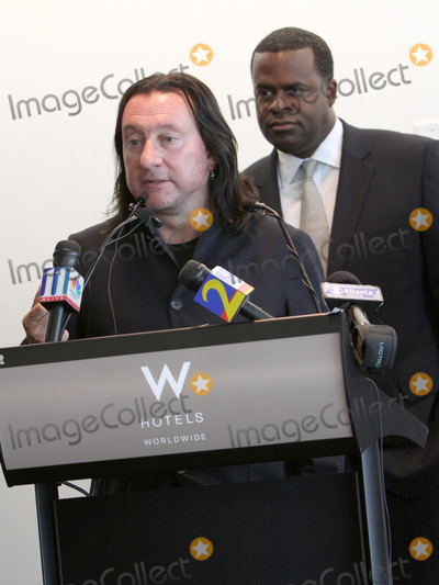 Kasim Reed Photo - July 6 2011 - Atlanta GA - Peter Conlon of LiveNation makes the concert announcement as Atlanta Mayor Kasim Reed looks on during a press conference at the downtown W Hotel to announce the return of the Music Midtown Music Festival with headliners Coldplay  Photo credit Dan HarrAdMedia