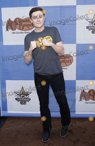 Scotty McCreery Photo - 18 April 2015 - Arlington TX -   Scotty McCreery  Cracker Barrel Country Checkers Challenge at The ACM Party For A Cause at Global Life StadiumPhoto Credit mjtAdMedia