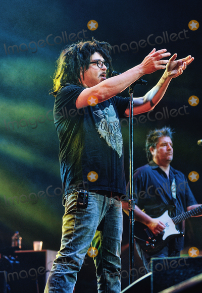 Adam Duritz Photo - 12 May 2015 - Hamilton Ontario Canada  Adam Duritz (vocalist) and David Immergluck (guitarist) of Counting Crows perform on stage at Hamilton Place Theatre Photo Credit Brent PerniacAdMedia