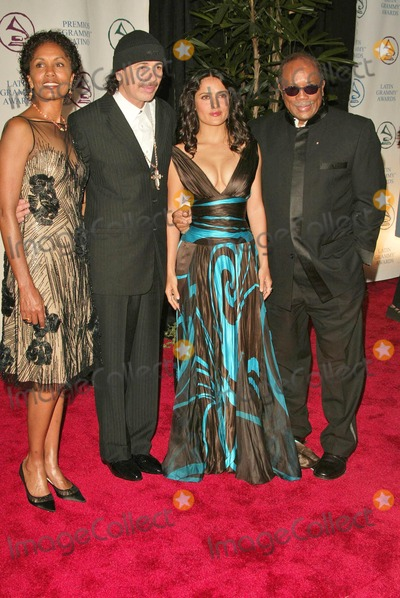 Carlos Santana Photo - Carlos Santana and his wife Deborah with Salma Hayek and Quincy Jones at the 2004 Latin Recording Academy Person of the Year Tribute to Carlos Santana at the Century Plaza Hotel Century City CA 08-30-04