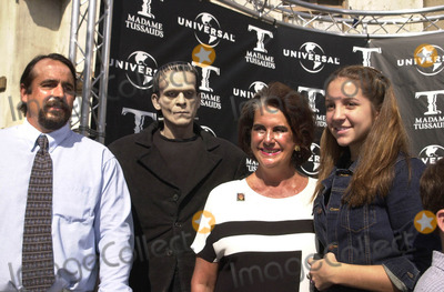 Sara Karloff Photo -  SARA KARLOFF SARAS SON MIKE AND GREAT GRANDDAUGHTER KACEY at the unveiling of Madame Tussauds lifelike wax portraits of Dracula Frankensteins Monster and The Mummy Universal Studios 10-10-01