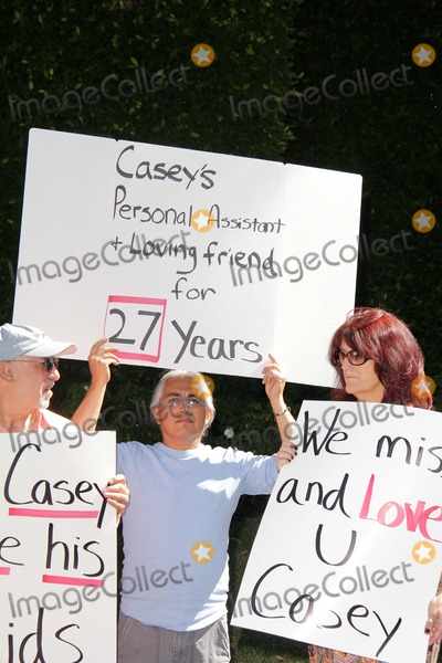 Casey Kasem Photo - Merrill Schindler Gonz Venecia Lorre Crimiat a protest involving Casey Kasems children brother and friends who want to see him but have been denied any contact  Private Location Holmby Hills CA 10-01-13