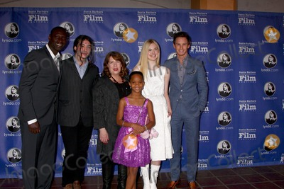 Ann Dowd Photo - SANTA BARBARA - JAN 29  Omar Sy Ezra Miller Ann Dowd Quvenzhane Wallis Elle Fanning Eddie Redmayne arrives at the  Santa Barbara International Film Festivals 2013 Virtuosos Award at Arlington Theater on January 29 2013 in Santa Barbara CA