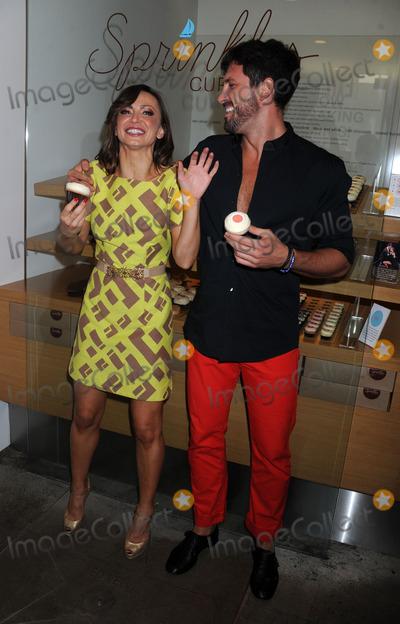 Karina Smirnoff Photo - Photo by Dennis Van Tinestarmaxinccom2013ALL RIGHTS RESERVEDTelephoneFax (212) 995-119671613Karina Smirnoff and Maksim Chmerkovskiy at a promotional event for Forever Tango Sprinkles Cupcake(NYC)