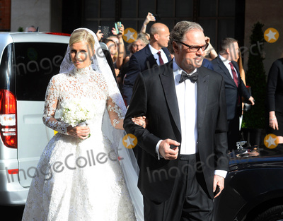 Nicky Hilton Photo - Photo by KGC-102starmaxinccomSTAR MAXCopyright 2015ALL RIGHTS RESERVEDTelephoneFax (212) 995-119671015Nicky Hilton - with her father Richard Hilton - is seen on her wedding day leaving Claridges Hotel en route to Kensington Palace for her marriage ceremony to James Rothschild(London England UK)