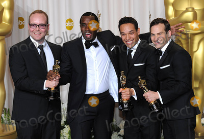 Sean Diddy Combs Photo - TJ Martin Dan Lindsay and Richard Middlemas with the Best Documentary Feature award received for Undefeated pose with Sean Diddy Combes at the 84th Academy Awards at the Kodak Theatre Los Angeles