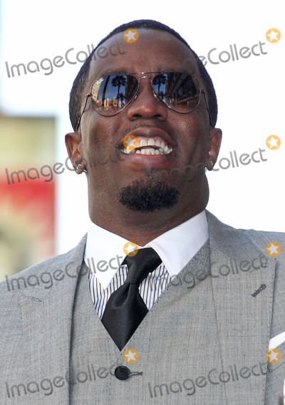 Diddy Combs Photo - Photo by REWestcomStarmaxinccom2013ALL RIGHTS RESERVEDTelephoneFax (212) 995-1196101013Sean P Diddy Combs Kenny Babyface Edmonds honored with a star on the Hollywood Walk of Fame in front of the W Hotel in (Hollywood CA)