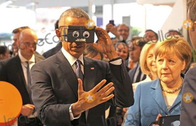 Angela Merkel Photo - US-President BARACK OBAMA and German chancellor ANGELA MERKEL testing virtual reality goggles when touring the Hannover Messe Hannover 25042016