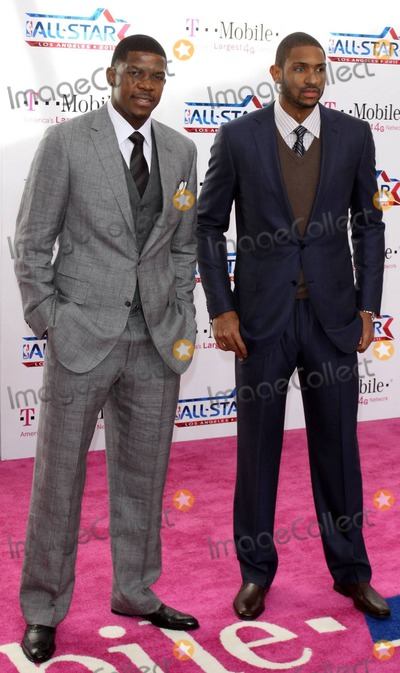 Al Horford Photo - NBA players Joe Johnson and Al Horford of the Atlanta Hawks pose for photographers on the pink carpet ahead of the 2011 NBA All-Star game held at the Staples Center which saw West win 148-143 over the East Los Angeles CA 022011