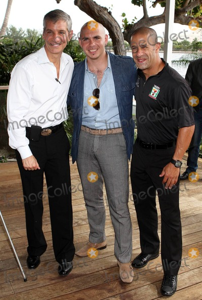 Alonzo Mourning Photo - (L-R) Miami Commissioner Marc Sarnoff musician Pitbull (Armando Prez) and IndyCar champion Tony Kanaan attend a press conference for the 1-800-411-PAIN Great Grove Bed Race held at Grove Isle Hotel and Spa in Coconut Grove  The Great Grove Bed Race will take place on September 4th and consists of four team members pushing sponsored beds on wheels down a street in Coconut Grove racing to the finish line with one rider on the mattress all to benefit Alonzo Mourning Charities and the University of Miami Sleep Center Miami FL 082410