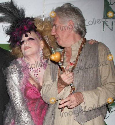 Bette Midler Photo - Crosby Stills Nash Midler8413JPGNYC  103009Bette Midler (dressed as a Showghoul) with Graham Nash at Bette Midlers annual HULAWEEN Gala supporting New York Restoration Project at the Waldorf AstoriaDigital Photo by Adam Nemser-PHOTOlinknet