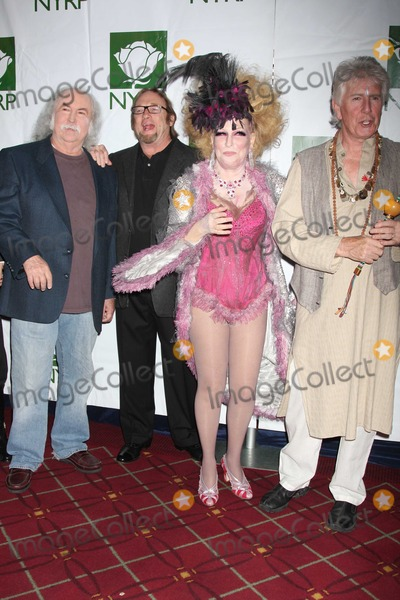 Bette Midler Photo - Crosby Stills Nash Midler8430JPGNYC  103009Bette Midler (dressed as a Showghoul) with David Crosby Stephen Stills and Graham Nash at Bette Midlers annual HULAWEEN Gala supporting New York Restoration Project at the Waldorf AstoriaDigital Photo by Adam Nemser-PHOTOlinknet