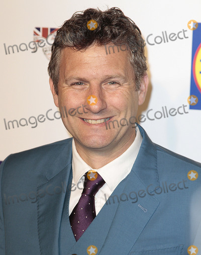 Adam Hills Photo - Dec 16 2014 - London England UK - British Comedy Awards Fountain Studios Wembley - Red Carpet ArrivalsPhoto Shows Adam Hills