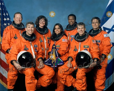 Kalpana Chawla Photo - FILE PHOTO  (October 2001) --- The seven STS-107 crew members take a break from their training regimen to pose for the traditional crew portrait Seated in front are astronauts Rick D Husband (left) mission commander Kalpana Chawla mission specialist and William C McCool pilot Standing are (from the left) astronauts David M Brown Laurel B Clark and Michael P Anderson all mission specialists and Ilan Ramon payload specialist representing the Israeli Space Agency Supplied by NASANY Photo Press       NY Photo Press    phone (646) 267-6913     e-mail infocopyrightnyphotopresscom