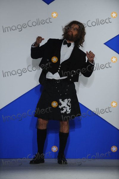 GEICO CAVEMAN Photo - The Geico Caveman poses in the Dressed To Kilt charity fashion show benefiting Friends of Scotland at M2 Lounge on March 30 2009 in New York City