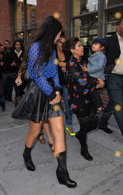 KYLIE KARDASHIAN Photo - April 24 2012 New York CityKylie Kardashian (R) and Kourtney Kardashian take Kourtneys son Mason for a walk in the Meatpacking District on April 24 2012 in New York City
