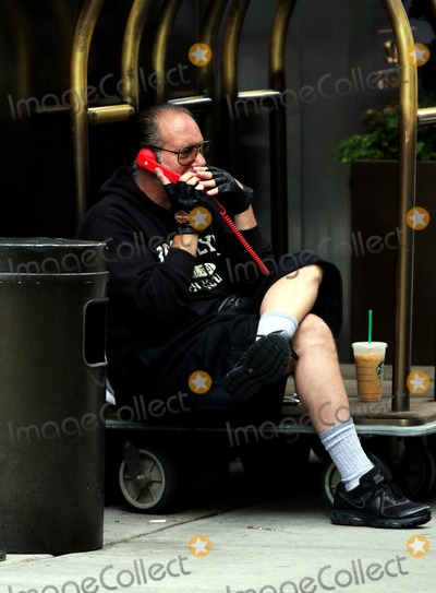 Andrew Dice Clay Photo - June 12 2014 New York CityActor Andtrew Dice Clay makes a phone call outside his Soho hotel on June 12 2014 in New York City