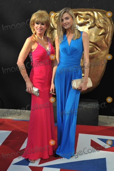 Sally Farmiloe Photo - Sally Farmiloe and daughter arriving for the BAFTA TV Awards 2012 at the Royal Festival Hall South Bank London 27052012 Picture by Steve Vas  Featureflash
