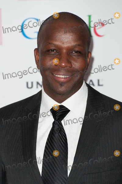 Amy Winehouse Photo - Donovan Bailey arriving for the Amy Winehouse Foundation Dinner London 20112013 Picture by Dave Norton  Featureflash