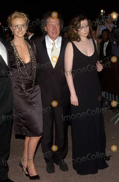 Geoffrey Rush Photo - GEOFFREY RUSH  CHARLIZE THERON (left)  EMILY WATSON at the party in Cannes following the gala screening of their new movie The Life  Death of Peter SellersMay 21 2004