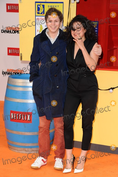Alia Hawkat Photo - Michael Cera and Alia Hawkat arriving for the Arrested Development Season Four  premiere at the Vue Leicester Square London 09052013 Picture by Steve Vas  Featureflash