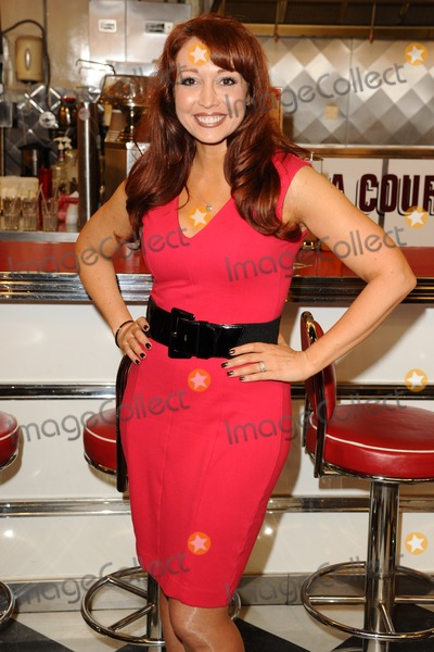Amy Anzel Photo - Amy Anzel at the photocall for Happy Days The Musical at Eds Easy Diner Trocadero London 08012014 Picture by Steve Vas  Featureflash