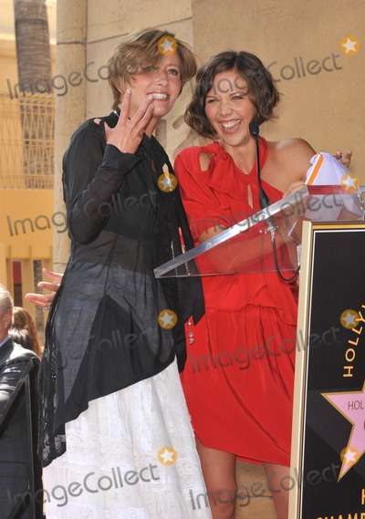 Emma Thompson Photo - Actress Emma Thompson with co-star Maggie Gyllenhaal (in red) on Hollywood Boulevard where Thompson was honored with the 2416th star on the Hollywood Walk of Fame The star is located outside The Pig n Whistle British pub Their new movie Nanny McPhee Returns opens in the USA on August 20th August 6 2010  Los Angeles CAPicture Paul Smith  Featureflash