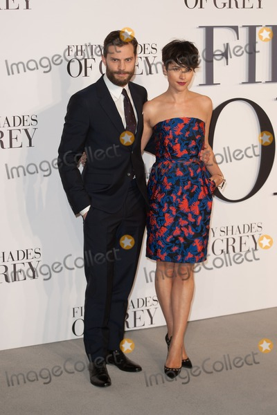 Jamie Dornan Photo - Jamie Dornan and wife arriving for the UK Premiere of 50 Shades of Grey at the Odeon Cinema Leicester Square London 12022015 Picture by Dave Norton  Featureflash