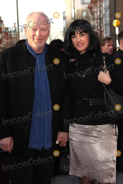 David Gilmour Photo - LondonUK  David Gilmour and wife Polly Sampson   at the World Premiere of the film comedy The Infidel Hammersmith Apollo London 8th April 2010 Keith MayhewLandmark Media