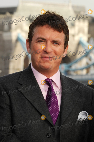 George Cole Photo - London UK Shane Richie poses to launch Fives remake of the popular 80s sitcom starring Dennis Waterman and George Cole at Tower Bridge13 JanuaryAli KadinskyLandmark Media