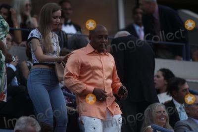 Daymond John Photo - Daymond John with Girl Friend at Usopen Tennis Gala Red-carpet at Arthur Ashe Stadium 8-25-2014 John BarrettGlobe Photos