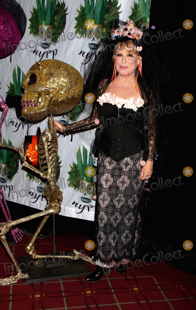 Bette Midler Photo - Bette Midler Arrives For Bette Midlers Hulaween Gala at the Waldorf Astoria in New York on October 28 2011 Photo by Sharon NeetlesGlobe Photos Inc