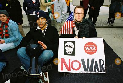 JFK Photo - Anti-war Protestors Jfk Memorial Dallas Tx 02-15-03 L-juan Facio (Dallas) 20 Years Old R-jase Donaldson (Dallas) 24 Years Old Photojeff Newman  Globe Photos Inc 2003