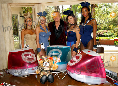 Vanessa Gleason Photo - K29724FB OPERATION PLAYMATE LAUNCHED BY PLAYBOYPLAYMATES IN BEVERLY HILLS CA THE PLAYMATES ARE MODELING EXCLUSIVE PLAYBOYBUNNY MILITARY OUTFITS3282003 PHOTO BY FITZROY BARRETT  GLOBE PHOTOS INC 2003SHAUNA SAND STEPHANIE HEINRICH HUGH HEFNER VANESSA GLEASON AND NEFERTERI SHEPHERD
