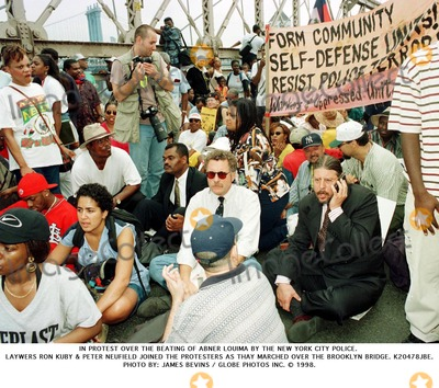 Abner Louima Photo - In Protest Over the Beating of Abner Louima by the New York City Police Laywers Ron Kuby  Peter Neufield Joined the Protesters As Thay Marched Over the Brooklyn Bridge K20478jbe James Bevins Globe Photos Inc 1998