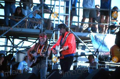 Waylon Jennings Photo -  82592 the Paul Simon Concert in Central Park NYC Willie Nelson with Waylon Jennings Photo by John BarrettGlobe Photos Inc