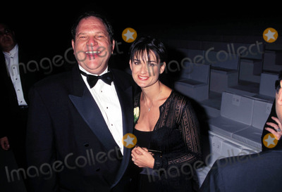 Demi Moore Photo - Aplal Gucci Fashion Show Santa Monica CA 1997 Demi Moore and Harvey Weinstein Photo by Lisa Rose-Globe Photos
