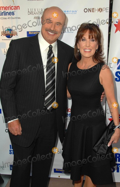 Robin McGraw Photo - a Night of Honor Fundraising Gala Event Benefitting the Iraq Star Foundation at the Universal City Hilton in Universal City CA 10-04-2009 Photo by Scott Kirkland-Globe Photos  2009 Dr Phil Mcgraw and Wife Robin Mcgraw
