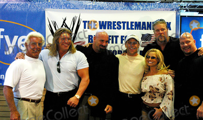 Bill Goldberg Photo - K31363RM WWE RAW SUPERSTARS RAISE FUNDS FOR FAMILIES OF FALLEN SOLDIERS IN THE WAR WITH IRAQ THE EFFORT KICKS OFF AT THE FYE STORE AT ROCKEFELLER PLAZA IN NEW YORK CITY 6232003 PHOTO BYRICK MACKLER  RANGEFINDERS GLOBE PHOTOS INC 2003(WWE SUPERSTARS) RIC FLAIR TRIPLE H BILL GOLDBERG SHAWN MICHAELS TRISH STRATUS KEVIN NASH AND STONE COLD STEVE AUSTIN