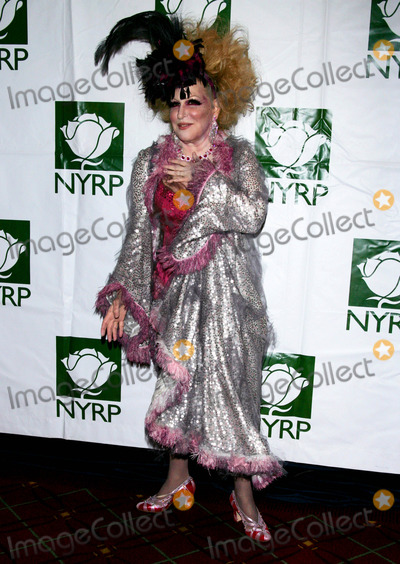 Bette Midler Photo - Bette Midler Arrives For the Hulaween Gala at the Waldorf Astoria in New York on October 30 2009 Photo by Sharon NeetlesGlobe Photos Inc