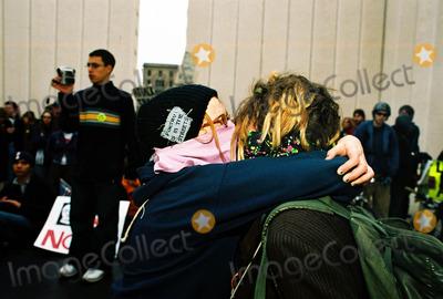 JFK Photo - Anti-war Demonstration Masked Demonstrators Make Love Not War Jfk Memorial Dallas Tx 02-15-03 L-star (Lincoln NE) R-cri (Fort Worth TX) Photojeff Newman  Globe Photos Inc 2003