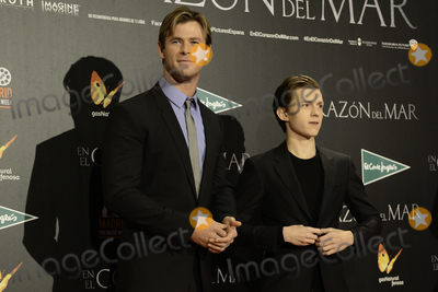 Tom Holland Photo - Chris Hemsworth (L) and Tom Holland (R)  -En el corazn del mar- (In the heard of sea) premiere at Madrid Premiere Week 2015 in Madrid