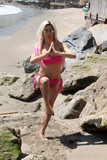 Photos From Frenchy Morgan spotted doing yoga and karate in a pink bikini