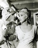 Marilyn Monroe,Tony Curtis Photos - Tony Curtis and Marilyn Monroe in a Scene From Some Like It Hot 1959 Supplied by Ipol ArchiveipolGlobe Photos Inc