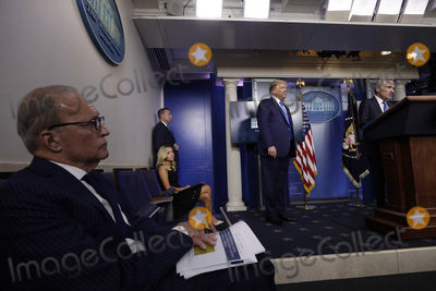 The National Photo - Scott Atlas adviser White House Coronavirus Task Force right speaks as Director of the National Economic Council Larry Kudlow White House Press Secretary Kayleigh McEnany and United States President Donald J Trump look on during a news conference at the White House in Washington on September 23 2020 Credit Yuri Gripas  Pool via CNPAdMedia