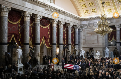 American Flag Photo - United States Senate Majority Leader Mitch McConnell (Republican of Kentucky) left speaks near the American flag-draped casket of United States Representative Elijah Cummings (Democrat of Maryland) during a memorial service in National Statuary Hall at the US Capitol in Washington DC US on Thursday Oct 24 2019 Cummings a key figure in Democrats impeachment inquiry and a fierce critic of United States President Donald J Trump died at the age of 68 on October 17 due to complications concerning long-standing health challengesCredit Al Drago  Pool via CNPAdMedia