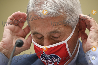 The National Photo - Anthony Fauci director of the National Institute of Allergy and Infectious Diseases wears a Washington Nationals protective mask during a House Select Subcommittee on the Coronavirus Crisis hearing in Washington DC US on Friday July 31 2020 Trump administration officials are set to defend the federal governments response to the coronavirus crisis at the hearing hosted by a House panel calling for a national plan to contain the virusCredit Erin Scott  Pool via CNPAdMedia