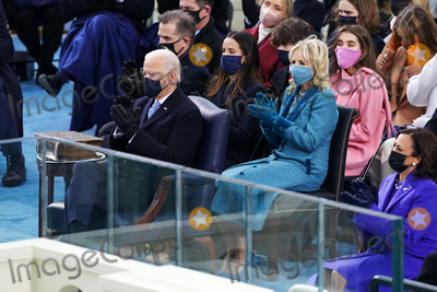 The Ceremonies Photo - NYTINAUG - President-elect Joe Biden and Dr Jill Biden during the ceremony The inauguration ceremony for President Joe Biden and Vice President Kamala Harris on the west front of the US Capitol in Washington on January 20 2021 NYTCREDIT Erin SchaffThe New York TimesAdMedia